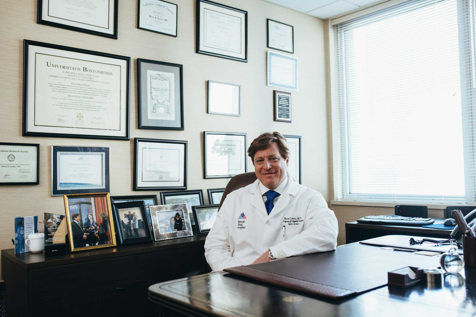 doctor-sitting-in-front-of-his-desk